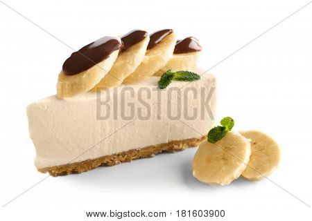 Delicious cheesecake slice with chocolate and bananas on white background