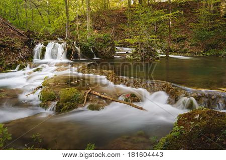 Beautiful small waterfall and rapids on a mountains river in springtime. Grza river, East Serbia