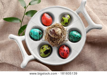 Easter eggs in stand on sackcloth