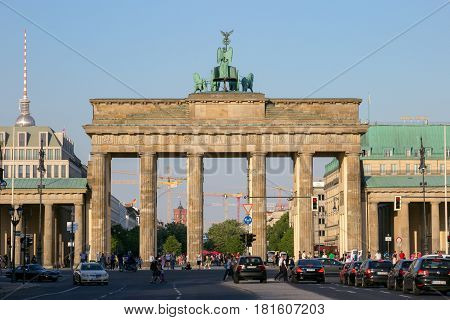 BERLIN GERMANY - MAY 22 2014: View on the Brandenburg Gate from in Berlin Germany. An 18th-century neoclassical triumphal arch in Berlin one of the best-known landmarks of Germany.