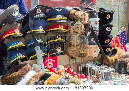 BERLIN GERMANY - MAY 23 2014: Sale stand of Soviet and DDR militaria souvenirs near Checkpoint Charlie.