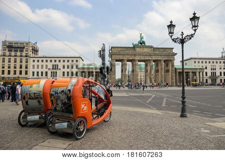 BERLIN GERMANY - MAY 23 2014: Taxi bikes in front of the Brandenburger Tor in Berlin Germany.