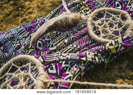 dress dreamcatcher lying on dry land. hipster style