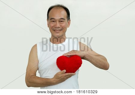 old man on whit shirt holding a red heart on white background