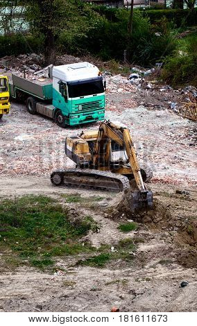 Hydraulic crawler excavator on the construction site dig hole