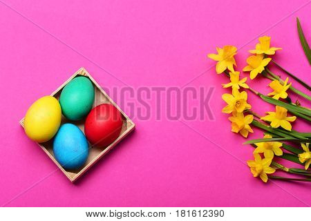 Colorful Easter Eggs In Wooden Box With Yellow Narcissus