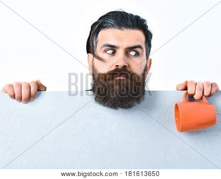 Bearded Brutal Caucasian Hipster With Paper Sheet And Cup