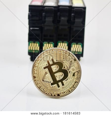 Bitcoin Gold Coin And Ink Cardridges