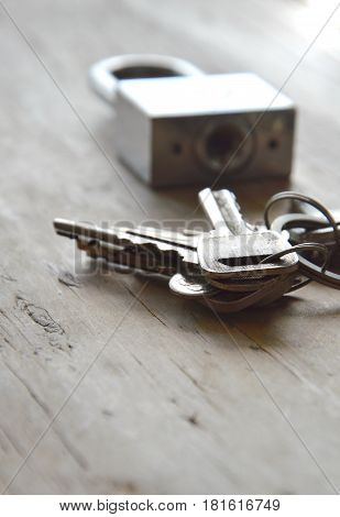 padlock and key chain for find matching on wooden board