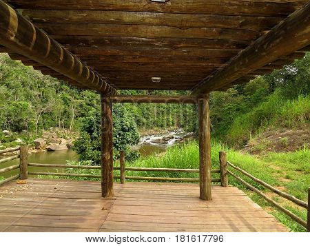 Wooden lookout with waterfall landscape in background
