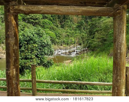 Wooden frame with waterfall landscape in the background