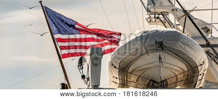 A yacht flying the stars and stripes at a marina in southern California.
