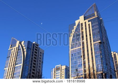 Modern skyscrapers on a background of blue sky. Tall buildings of the big city.