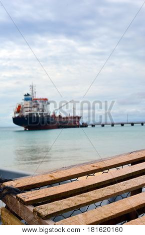 Big Corn Island Nicaragua oil tanker at dock on Picnic Center Beach with lobster pot trap on Caribbean Sea