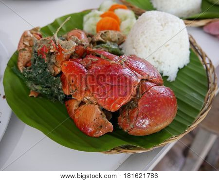 Giant coconut crab platter Cooked giant coconut crab with a serving of rice and salad