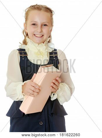 Dressy girl schoolgirl in black dress and white blouse holding a textbook and smiling cheerfully at the camera. Close-up.Isolated on white background.