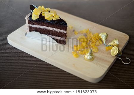 Sweet brownie chocolate cream cake topped with corn flake