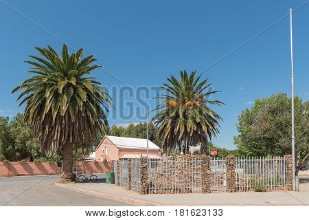 WILLOWMORE SOUTH AFRICA - MARCH 23 2017: A street scene with a monument of an Angora Goat in Willowmore commemorating the role mohair play in the local industry