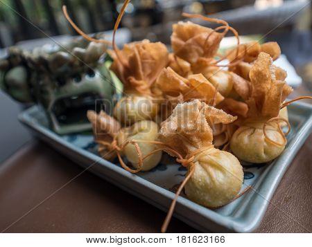 Crispy wonton with sweet sauce and vegetable