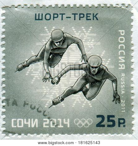 GOMEL, BELARUS, APRIL 13, 2017. Stamp printed in Russia shows image of  The 2014 Winter Olympics, officially called the XXII Olympic Winter Games, circa 2013.