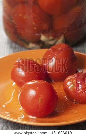 Marinated tomatoes on a plate close up shot