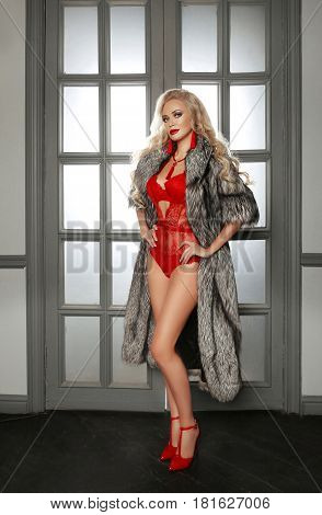 Beautiful Alluring Sexy Woman Portrait In Red Fashion Lingerie And Shoes Heels Wears Sable Fur Coat