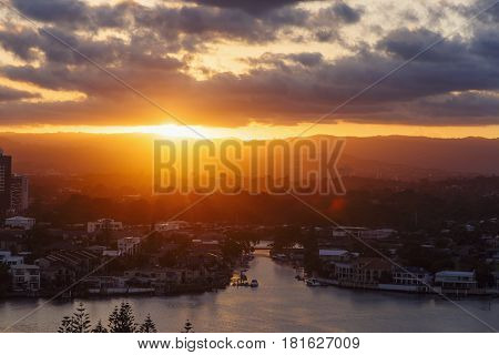 GOLD COAST AUSTRALIA - January 16 2015: Sunrays and sunset with amber and golden tones over the city of Gold Coast Queensland Australia