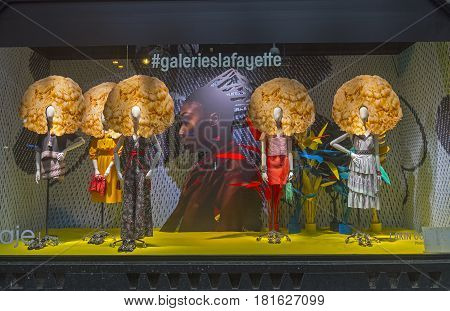 PARIS FRANCE - MARCH 27 2017: Mannequins in the showcase of the Galeries Lafayette Haussmann department store in Paris France.