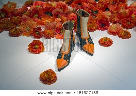 PARIS FRANCE - MARCH 27 2017: Details of the shop window decoration in the Printemps department store in Paris France. Women's shoes. Spring and summer theme.