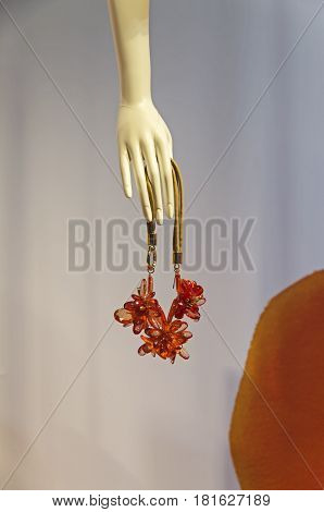 PARIS FRANCE - MARCH 27 2017: Details of the shop window decoration in the Printemps department store in Paris France. Bijouterie in the hand of a dummy.