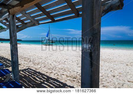 Catarmaran seen under the shelters off Playa Pilar in Cuba.