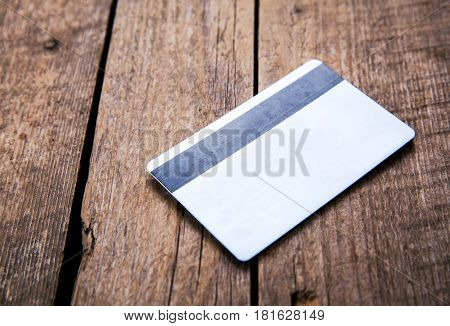 Credit card on a wooden background and