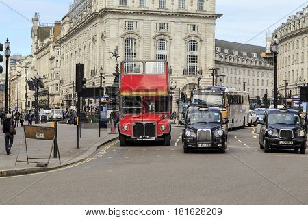 LONDON, GREAT BRITAIN - MAY 12, 2014: Piccadilly Circus is a famous square and a traffic intersection in the city center.