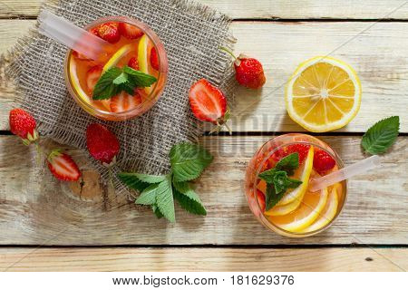Refreshing Summer Drink Strawberry Mojito On A Wooden Table. The Concept Of Eating Vegetarians, Fres