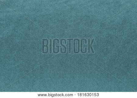 abstract background and speckled or mottled texture of fabric or textile material of turquoise color