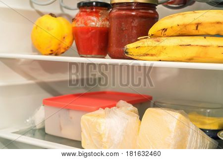 Open fridge with usual daily food of average man