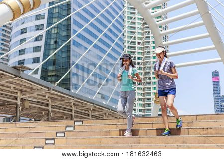 two female joggers pursuing their activity outdoors in the city