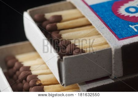 white matchbox with matches on the table