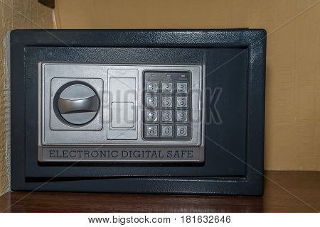 Closeup of front view combination safe in hotel room