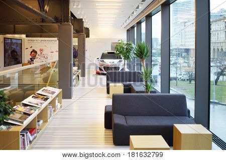 MOSCOW - APR 16, 2016: Room of library and car in Hyundai Motorstudio. Hyundai Motor announces about action dedicated to sale of 500 000 Solaris vehicles