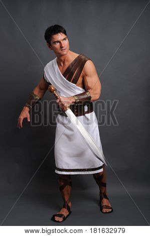The attractive man is wearing Roman warrior gear.
