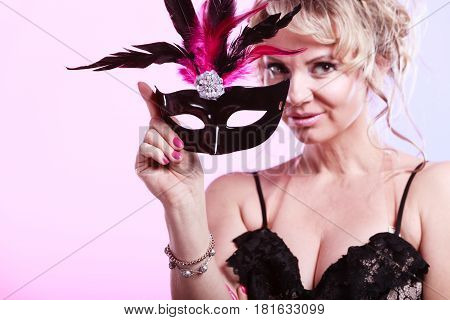 Woman Middle Aged Holds Carnival Mask.