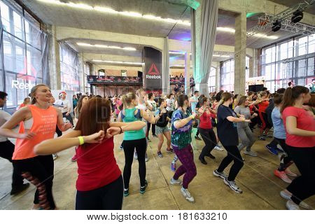 MOSCOW - APR 16, 2016: Women dance on fitness in DI Telegraph. Everyone will be able to exercise free of charge at Reebok sites in Moscow park