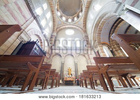 MARSEILLE, FRANCE - JUL 30, 2016: Interior of sunny Marseille cathedral with wooden benches