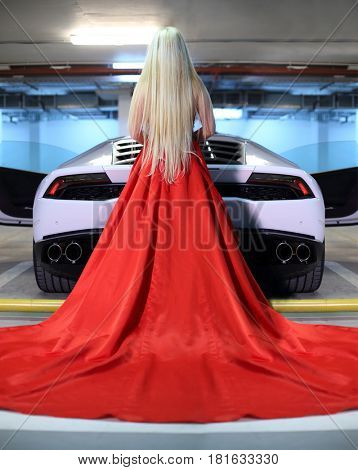 MOSCOW - MAY 20, 2016: Beautiful woman (with MR) in red near at Lamborghini Huracan LP 610-4. Lamborghini Huracan is world first production car, using inertial navigation system