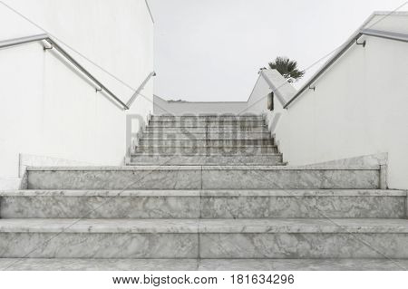 Outdoor empty white marble stairs leading upstairs