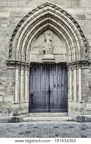 Stone portal of medieval church in Reims France