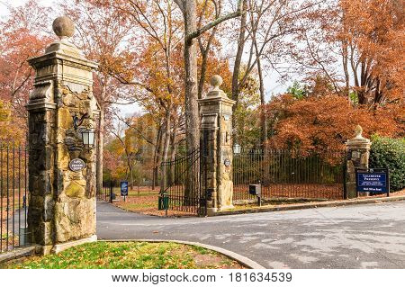 Wrought gate at the entrance to the autumn Lullwater Park Atlanta USA