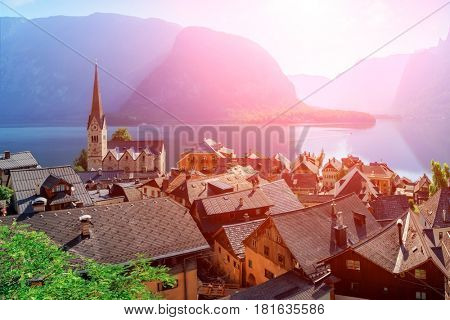 Sunny summer day in the Hallstatt village in the Austrian Alps. Maria am Berg church and Hallstattersee lake, Austria, Europe.