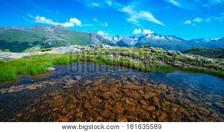 Amazing view of small lake near Totensee lake on the top of Grimselpass. Alps, Switzerland, Europe.